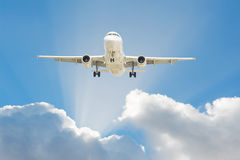 Airplane in the sky. Large passenger airplane flying in the blue sky Stock Photography