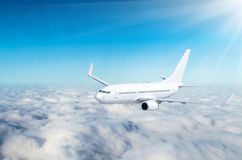 Airplane in the sky above the clouds flight journey sun height.  Stock Photo