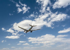 Airplane on the sky background Stock Image