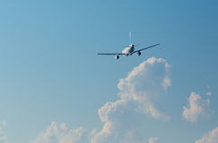 Airplane in the sky Royalty Free Stock Photos