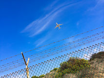 Airplane in Sky Stock Images