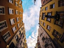 Airplane in sky between buildings Stock Photos
