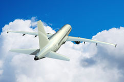 Airplane. In the sky with clouds 3D rendering Stock Photo