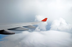 Airplane sky clouds flight airport wind view thunderstorm.  Royalty Free Stock Photos