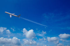 Airplane in the sky with clouds Stock Photo