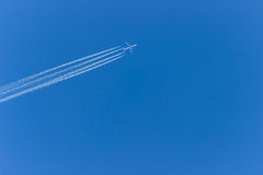 Airplane in the sky. Airplane flying across the sky,clear sky Stock Image