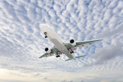 Airplane in the sky Good weather day background. Royalty Free Stock Photography