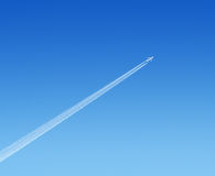 Airplane in the sky. Airplane high in the blue sky Royalty Free Stock Images