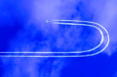 Airplane in the sky with jet t Royalty Free Stock Photo
