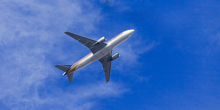 Airplane sky from land Royalty Free Stock Image