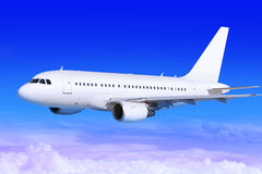 Airplane in the sky landing away Royalty Free Stock Photos