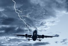 Airplane in the sky. With lightning Stock Photo