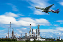Airplane in the sky over Oil Refinery factory industry. With blue sky and clouds. Petrochemical plant , Petroleum , Industrial-plant stock image