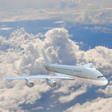 Airplane in the sky - Passenger Airliner / aircraft Royalty Free Stock Image