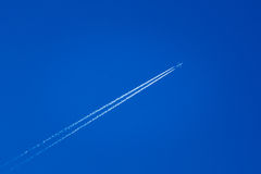 Airplane In The Sky With Plane Trails Stock Image