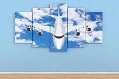 Airplane in the Sky Poster in Empty Room on a Blue. 3d Rendering. Airplane in the Sky Poster in Empty Room on a Blue Wall background. 3d Rendering Stock Photography