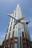 Airplane and Sky Scraper Stock Photography