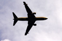 Airplane in the sky, silhouette. Airplane in mid air, silhouette Stock Images