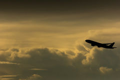 Airplane in the sky, silhouette photo Stock Photos