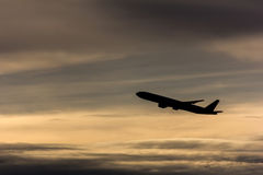 Airplane in the sky, silhouette photo Royalty Free Stock Images