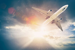 Airplane in the sky at sunset. Amazing trip. Travel concept. Stock Photo