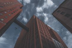 Airplane on sky with tall building Stock Images