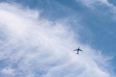 Airplane on the Sky Under White Cloudy Blue Sky during Daytime Stock Photo