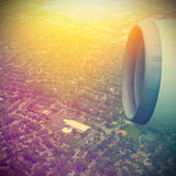 Airplane in the sky. View on the city royalty free stock photo