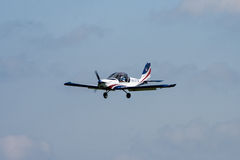Airplane. A small propeller airplane in blue and white on a flight show flying in the air Stock Photo