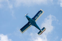 Airplane. A small propeller airplane in blue and white on a flight show flying in the air Royalty Free Stock Image