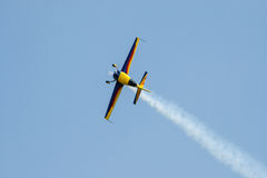 Airplane. A small propeller airplane in blue and yellow on a flight show flying in the air Stock Photo