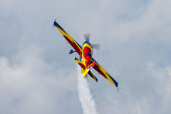 Airplane. A small propeller airplane in blue and yellow on a flight show flying in the air Stock Photos