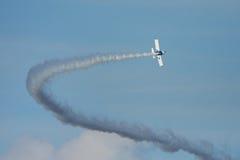 Airplane with smoke Stock Photos