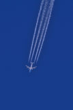 Airplane with smoke trail Stock Images