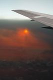 Airplane in smoked ash clouds. Volkano eruption. Stock Image
