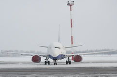 Airplane in the snow Stock Images