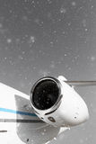 Airplane in the snowfall Stock Image