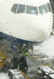 Airplane at snowstorm Royalty Free Stock Photos
