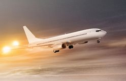 Airplane in snowstorm at night. White plane taking off at non-flying weather, snowstorm Royalty Free Stock Image