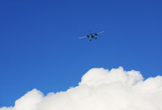 Airplane Soaring Above Clouds Royalty Free Stock Photography