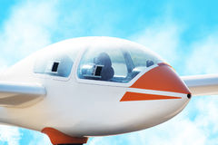 Airplane soaring through the sky Stock Image