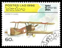 Airplane Sopwith Camel. Laos - circa 1996: Stamp printed by Laos, Color edition on Antique aircrafts, shows airplane Sopwith Camel in flight, circa 1996 Royalty Free Stock Images