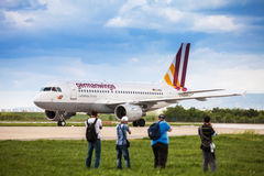 Airplane spotters taking photos of Germanwings Airbus Stock Image