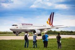 Airplane spotters taking photos of Germanwings Airbus Stock Image