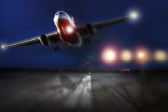 Airplane starting in the evening Royalty Free Stock Images
