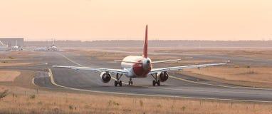 Airplane on a starting runway evening sundown. A airplane on a starting runway Royalty Free Stock Photo