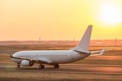Airplane on a starting runway evening sundown. A airplane on a starting runway Stock Photos