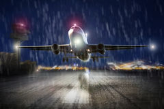 Airplane starting in an storm in the evening Stock Photo