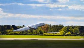 Airplane starts at sunshine. stock images