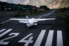Airplane staying on the airfield of Lukla stock photo